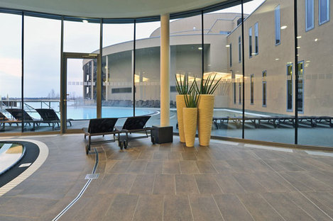 View of the big window separating the indoor pool and the outdoor pool
