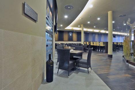 Basalto Grigio and Rovere Antico flooring by Ariostea