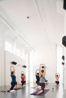 One of the yoga rooms: white reduces the impact of the exposed installations
