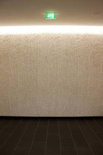 Lastra nera on the floor and bamboo wall decoration