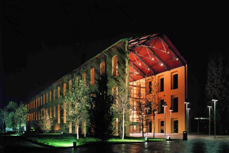 Contemporary architecture by day, ancient ways by night