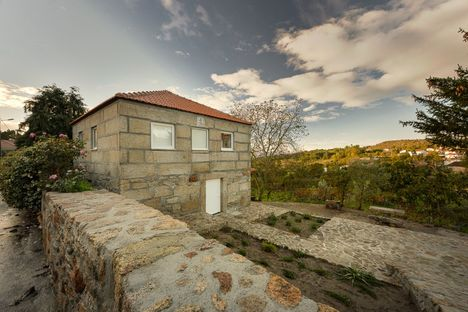 Wood Structure Inside Stone Walls by Corpo Atelier