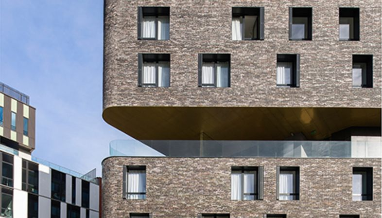 Compact, sustainable housing in Paris with a crèche, by Chartier Dalix