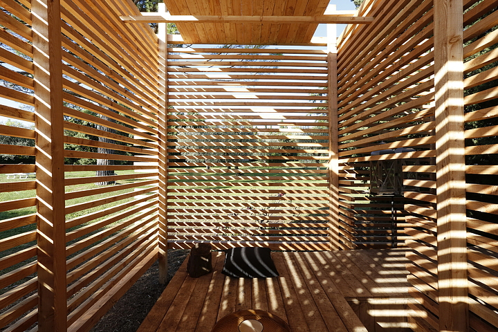 The pavilion is covered with thin larch wood slats, giving the interior  that sense of protection you need for the tea ceremony and at the same time  enabling ...