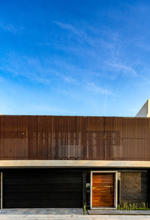 Taller64Arquitectos' Casa-7 is screened-off but open to dialogue