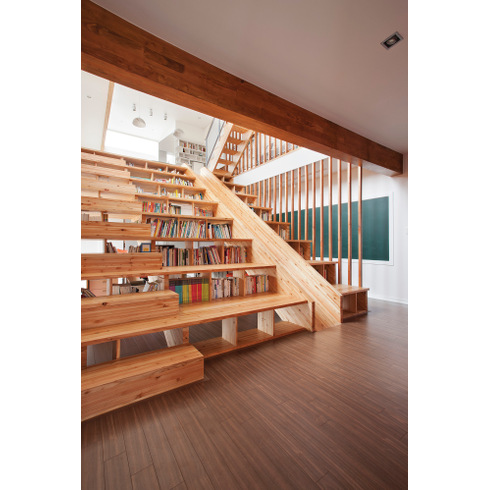 The Upper Part Of The Two Level Home Is Reserved For The Parents And The  Focal Point Is The Multifunctional Wooden Staircase That Integrates  Bookshelves And ...