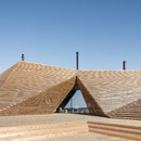 Avanto Architects creates a dome made of strips of wood for a restaurant with a sauna