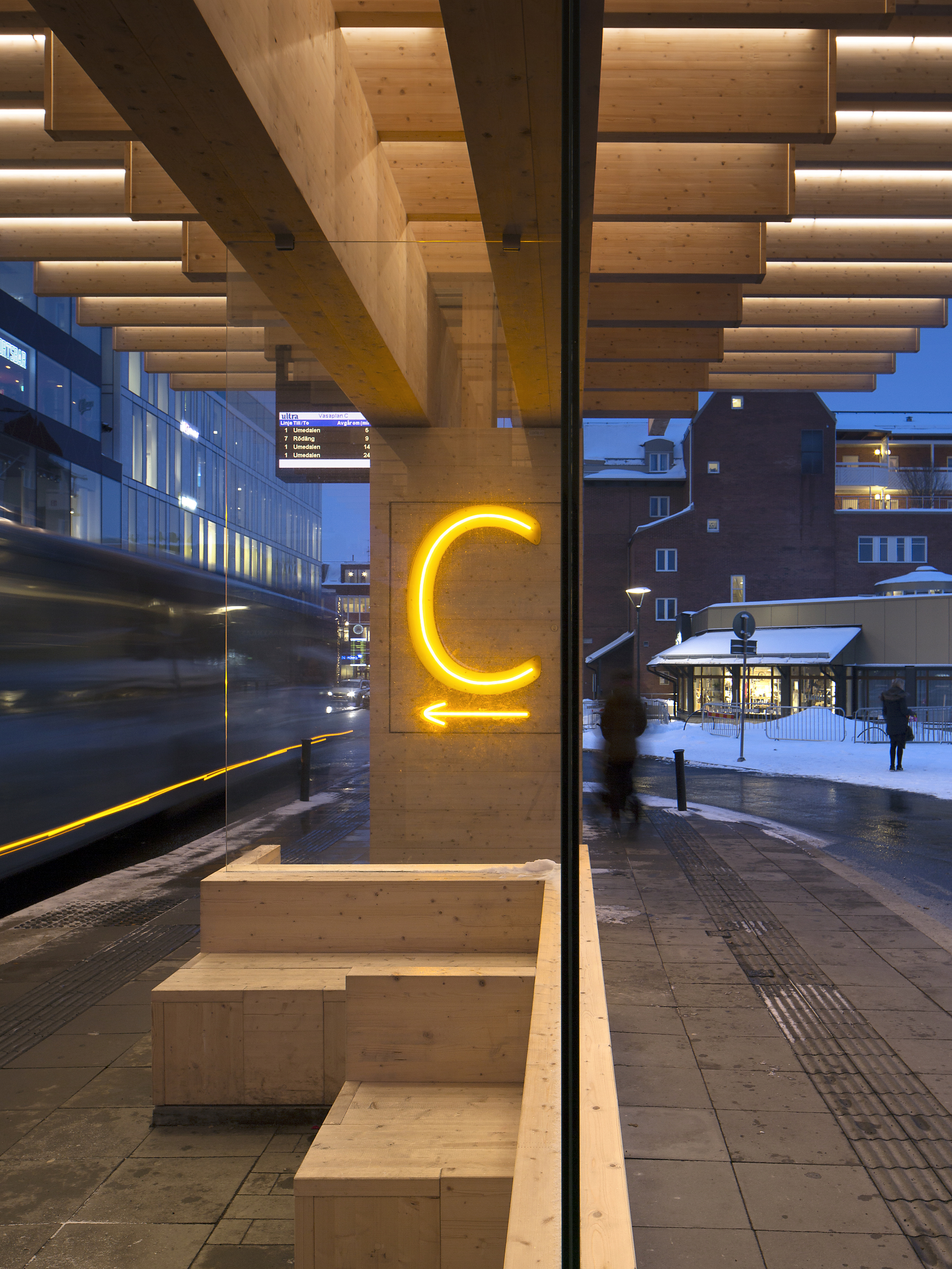 A structure made of concrete and laminated timber for a bus shelter in Umeå, Sweden.