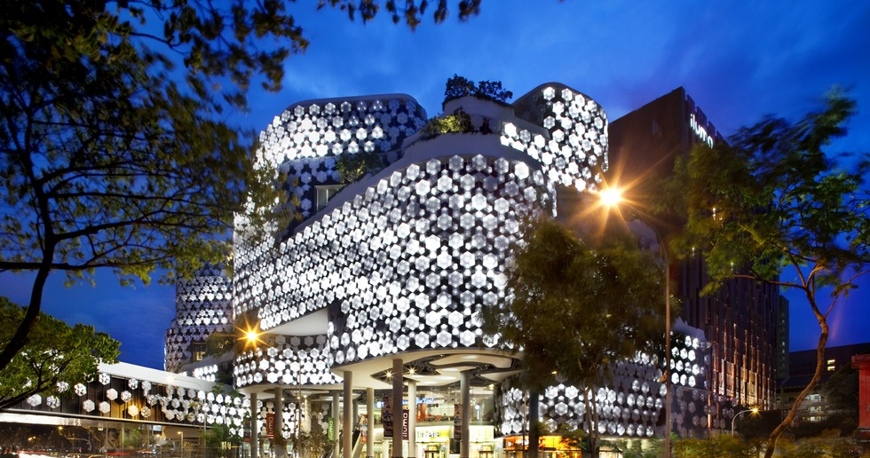 WOHA's Iluma building has a multimedia façade and crystal-shaped fixtures