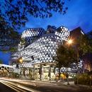 WOHA's Iluma building has a multimedia façade and crystal-shaped fixtures