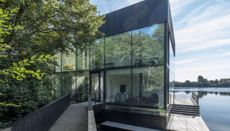 Mecanoo's glass and steel house on stilts