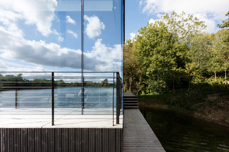 Mecanoo's glass and steel house on stilts