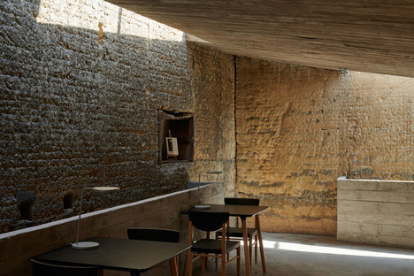 House renovated and transformed into a concrete and steel bookshop by TAO Architects
