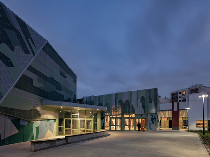 Prefabricated concrete renovation and addition with a perforated aluminium façade