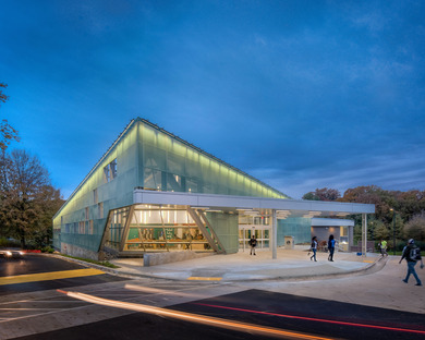 A translucent façade with neon lighting for Carrollton Library